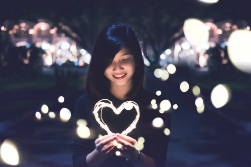Girl with a lighted heart shape.