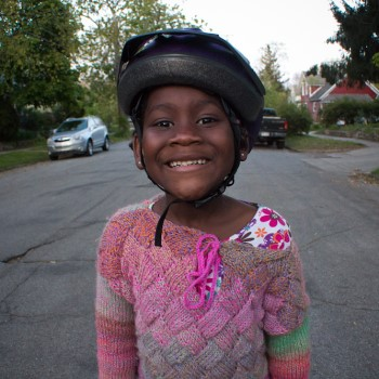 child with bike helmet