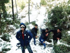 Guys throwing snowballs